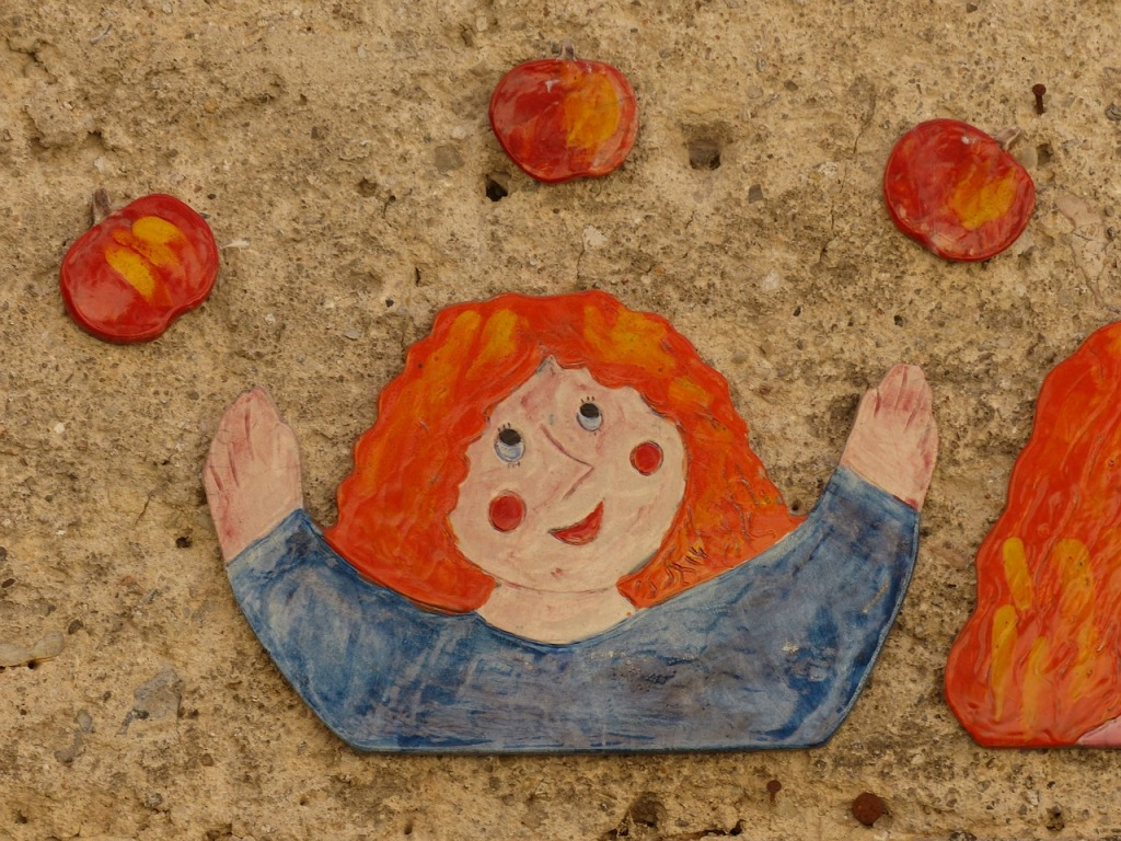 Woman juggling apples. Image from Pixabay.