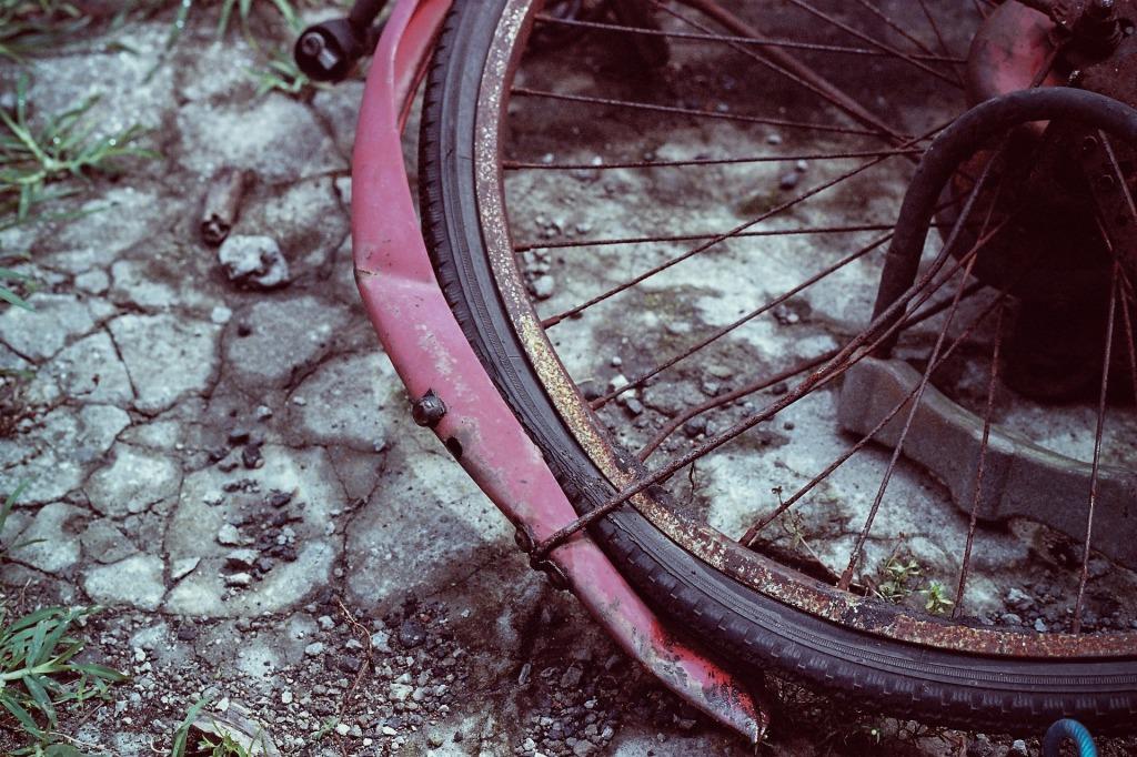Broken bicycle wheel on stones