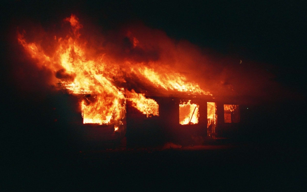 House on fire at night